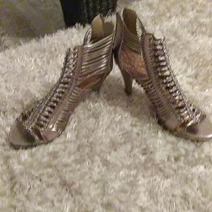 Strappy Healed silver metallic standals. Size 9